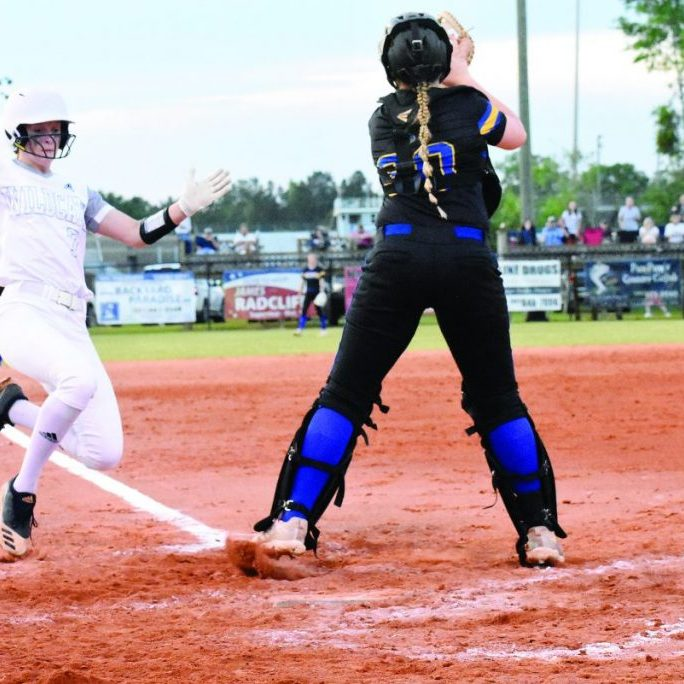 Eighth grader Erin Meadows is shown sliding safely into home for the go-ahead run Monday night against visiting Sumrall. The 3-1 win pushed GCHS to 6-0 in region play and secured the program's first regular season region championship and a first-round playoff bye as a No. 1 seed. Photo by Russell Turner - Herald Editor