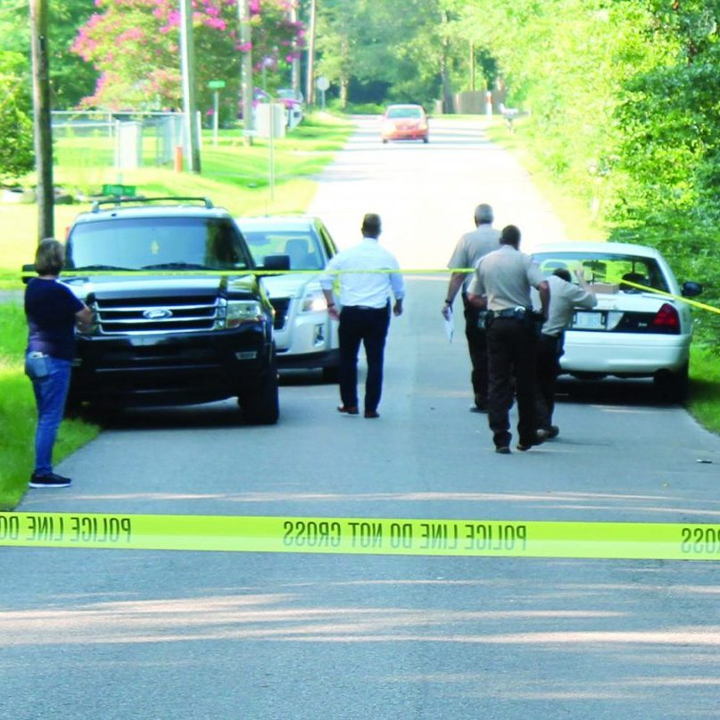 Officers are shown at the location where a local man's body was found early Thursday in Leakesville.